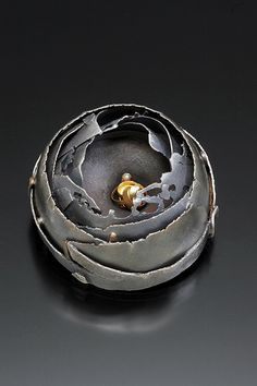 "Brooch ""vespa"" by Andy Cooperman.   silver, gold, diamonds- inspired by a wasp's nest!"