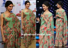 Wearing a floral Sabyasachi sari with an embellished blouse, Deepika taped a television show in Mumbai yesterday. Pairing the georgette sari with Isharya earrings and a pair of jootis, the actor finished out the look with an updo, winged eyeliner and a red lip. It's a whole lot of print but, it worked on her; …