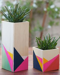 11 DIY Planters Your Houseplants Need Create an amazing tablescape with these cute wooden centerpieces, made with thin wood and acrylic paint. Pot your favorite succulents in an old glass and hide it inside to complete the look. See the directions at Tell Wooden Centerpieces, Succulent Centerpieces, Wedding Table Centerpieces, Succulent Pots, Centerpiece Ideas, Graduation Centerpiece, Quinceanera Centerpieces, Easter Centerpiece, Plant Pots