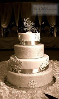 Custom crystal snowflake monogram wedding cake topper -pinned by wedding specialists http://dazzlemeelegant.com