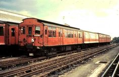 District Line 4 car 'Q' stock train at Ealing Common Depot