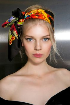 Topknots are the obvious hairstyle for warmer temps but pairing it with a brightly colored scarf is the perfect way to avoid looking basic.