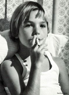 Tatum O'Neal (age 9) puffs away in Paper Moon. (1973) youngest person to ever win academy award
