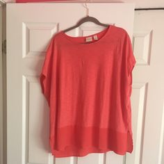 Beautiful orange easy wear Chico's top Beautiful orange Chico's top. So comfy. Runs large. Sluts in the sleeves and material changes in the bottom, so pretty. Size 2 Chico's, but fits a larger body. New Chico's Tops Tunics