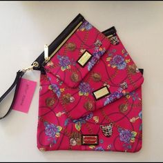 """BETSEY JOHNSON 3 PIECE POUCH SET, BRAND NEW . 3 piece assorted size Betsey Johnson bag/case set . Style: 3 PC Zip Print: Lioness Bouquet - Fuschia . Small Bag: Approx. 8"""" wide x 6"""" tall x .5"""" thick . Medium Bag: Approx. 10.5"""" wide x 8.5"""" tall x .5"""" thick . Large Bag: Approx. 13"""" wide x 10.5"""" tall x .5"""" thick . New with tags - Retail: $58 . 100% Authentic Betsey Johnson  These bags are brand new and have never been used. Perfect for all your cosmetic and toiletry needs. Can also be used as a…"""