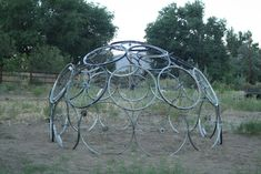 Build a dome from old bicycle wheels, plant squash and bean vines, and make a great summer house for kids!