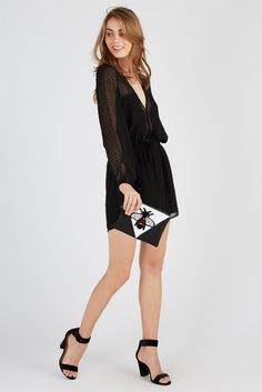 Sheer Sleeve Playsuit </br></br> Cannot get enough playsuits this season, seriously. This sheer, long sleeve playsuit is the perfect addition to your party wardrobe. With a tie-up detail waist, and plunging neckline you won't even need to worry about accessories girl, this playsuit speaks for itself! </br> - Jumpsuit </br> - Long sleeves </br> - Deep V neckline </br> - Elasticized waist </br> - Available in: black, ...