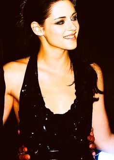 Kristen Stewart. Smiles but glossy and dressy