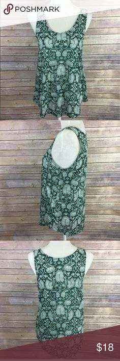 H&M CONSCIOUS Hawaiian Leaf Floral Tank Top Green H&M CONSCIOUS Collection Women's Tank Top Hawaiian Floral Leaf Green & Cream Shirt Size: Small  Photos show measurements of shirt listed for sale. Top is in very good condition. Please message me with any questions before you purchase.  Happy Shopping! 🛍😊 H&M Tops Tank Tops