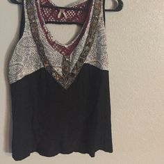 Gimmicks tank. Gimmicks tank black body with maroon trim. Beading on v, big open hole on back, layered front bottom. Worn once. Gimmicks by BKE Tops Blouses