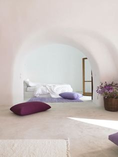 A shabby white room with arches and a lot of cushions: Perivolas Hotel in Greece. #home #decor #pillows