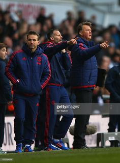 Louis van Gaal manager of Manchester United and Ryan Giggs assistant manager of Manchester United signal to players after the Barclays Premier League match between Tottenham Hotspur and Manchester United at White Hart Lane on April 10, 2016 in London, England.