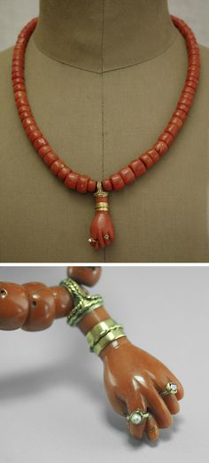 Antique red coral and gold bead necklace with figa hand pendant.