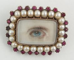 Eye miniature brooch  Georgian  C. 1820-1830    Lovely blue eye miniature surrounded by pearls and garnets.