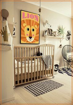 Monochrome nursery with wood accents and a pop of colour