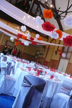 Hanging pom pom balls with draping & fairy lights create a colourful and fun look by A Touch of Elegance, The Chapel, Mission Estate Winery, HAWKES BAY