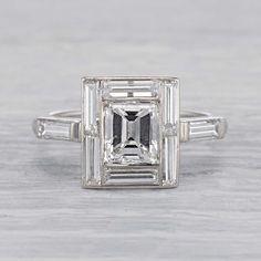 1.40 carat emeraldcut ring featuring eight baguette diamonds in a stunning geometric erstwhilerings