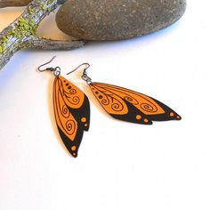 Wing earrings painted wood and Handmade! Find them at this really cool shop   https://www.zibbet.com/crowsdancedesigns