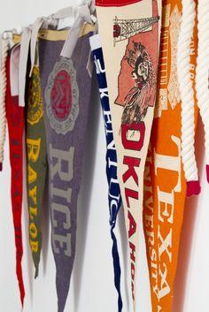 Vintage pennants tied on wooden pegs