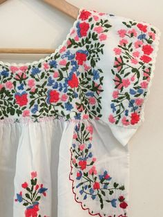 5ddc037d2 Beautiful vintage Mexican dress from the 70s Hand embroidered detailing  features soft pink and pastel flowers