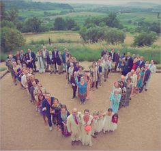 For a small wedding party, have all the guests line up in the shape of a heart and photograph from above.