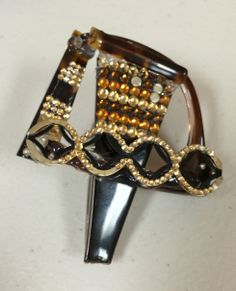 #upcycled Swarovski crystal brooch created by A&A Optical employee