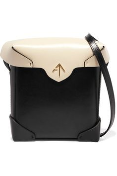 Manu Atelier's Pristine mini two-tone leather shoulder bag is so-called because of its unspoiled appearance – it's meticulously crafted from hand-cut leather in a neat, structured shape and finished with painted edges | 495