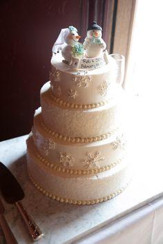 Winter wedding snowman and snowflake wedding cake