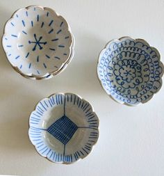 Scalloped bowls with simple patterns