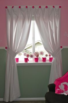 hang curtains on decorated knobs instead of a curtain rod.....love the decor of this little girl's room