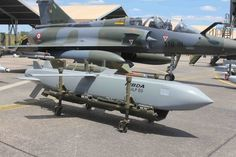 Scalp-EG missile on it's loading cradle in front of a Dassault Mirage 2000D. French Armée de l'Air.