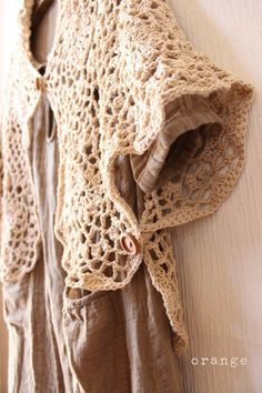 Great idea from meee orange, adding buttons to your shawl.