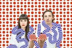 snake over shoulders, girl and guy, dots