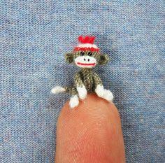Micro crocheted Sock Monkeys (SuAmi/Etsy)