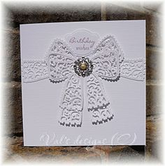 Tattered lace chantilly lace bow.