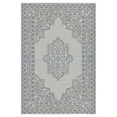 Eco-friendly indoor/outdoor rug with a floral motif. Made in Thailand.  Product: RugConstruction Material: Recycled polypropylene, polyester and nylon ribbonColor: Cool silverFeatures:  Packaged with handy Velcro stays to keep corners down in windy locationsMuted tones  Note: Please be aware that actual colors may vary from those shown on your screen. Accent rugs may also not show the entire pattern that the corresponding area rugs have.