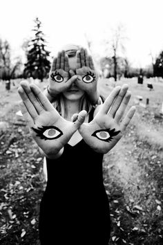 Paint eyes on hands.