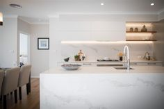 Iluka Designs, exclusive to G.J. Gardner Homes, provides four separate living zones, effortlessly cater for all members of the family. A well-appointed kitchen and a butler's pantry create a natural entertaining hub which partners with a family and lounge room opening onto a huge alfresco. Taking inspiration from the simple pleasures in life, Iluka prioritises stylish interiors, sublime connections to the outdoors and lets you easily enjoy life just the way it should be lived. #displayhome