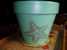 adorable flower pot painted and embellished with rhinestones! love it!