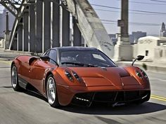 Luxury Cars  :   Illustration   Description   Car Porn of the Day: a Chocolate Pagani Huayra on the road!