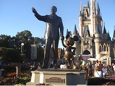The towering famous statue of Walt Disney and Mickey at the Magic Kingdom is definitely a favorite photo stop for guests!