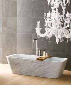 Swooning over everything in this picture - the tub, tray, floor and chandelier