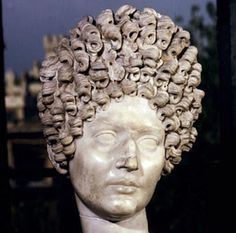 In ancient Rome the tendency was to follow Greek styles. Wealthy women wore ornate piles of curls on the tops of their heads, shaped around wire frames. These elaborate updos were created by slaves and servants often with the aid of crude curling irons.    Having gold dust sprinkled among the strands was a definite status symbol. Equally popular were blonde hairpieces which were made from the hair of captive slaves. In contrast men's hair was kept short and even shaved on occasion.
