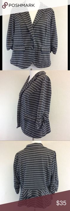 """2X TORRID striped ruffled hem blazer Brand: Torrid  Style: ruffle hem blazer Size: 2X Approximate Measurements: pit to pit 20"""" shoulder to hem 23.5"""" Material: 74% polyester 24% rayon 2% spandex Features: ruffled back, ruched Sleeves, 2 button closure, front faux pockets Condition: very good pre-loved, start of light piling under arms torrid Jackets & Coats Blazers"""