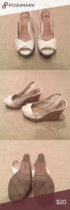 White and Cork Wedges Only worn a few times! A few minor spots that could be easily removed from the white fabric! In great condition! MIA Shoes Wedges