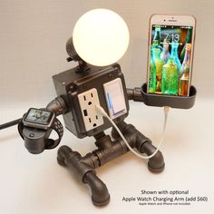 Steampunk Industrial Robot Pipe Desk Lamp with Dimmer, 2 AC & 2 USB outlets, Smartphone Charging Cradle, optional Apple Watch Charger AirBnB Industrial Pipe Desk, Industrial Robots, Industrial Furniture, Vintage Industrial, Robots Steampunk, Steampunk Lamp, Steampunk Gadgets, Apple Watch, 12 Volt Led