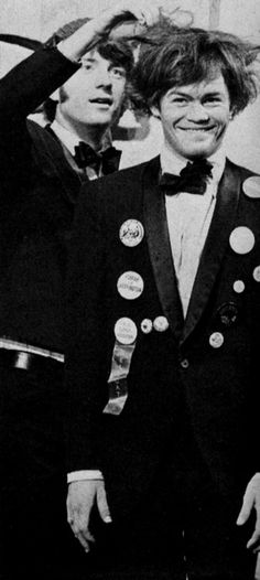 Micky Dolenz and Mike Nesmith...looks like Mike is trying to help Micky get his natural hair back