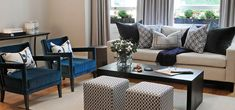 west london luxury reception room using interior designers at affordable price showing a blue velvet chair and formal sofa