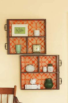 Hang old drawers on the wall and line the inside with pretty paper!