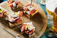 Finger food. Super-easy and tasty pintxos (tapas): Quince, ham & blue cheese. If you don't like blue cheese, manchego or a sharp cheddar works perfectly.